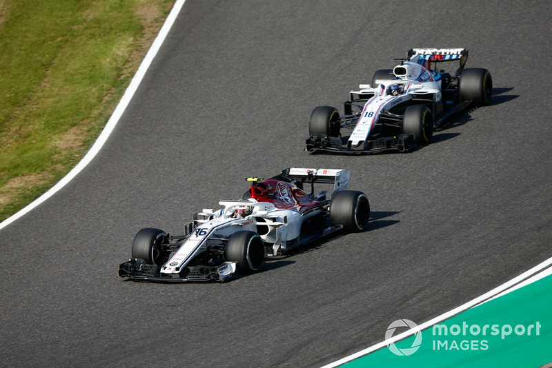 Charles Leclerc, Sauber C37, leads Lance Stroll, Williams FW41