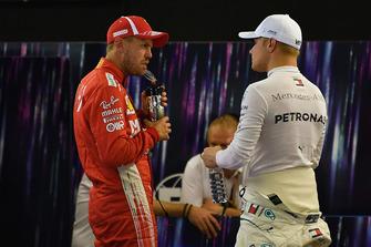 Sebastian Vettel, Ferrari and Valtteri Bottas, Mercedes AMG F1 in Parc Ferme in Parc Ferme
