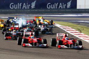 Fernando Alonso, Ferrari F10 passes team mate Felipe Massa, Ferrari F10 on the first lap of the race