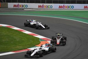 Kevin Magnussen, Haas F1 Team VF-18 Lance Stroll, Williams FW41 and