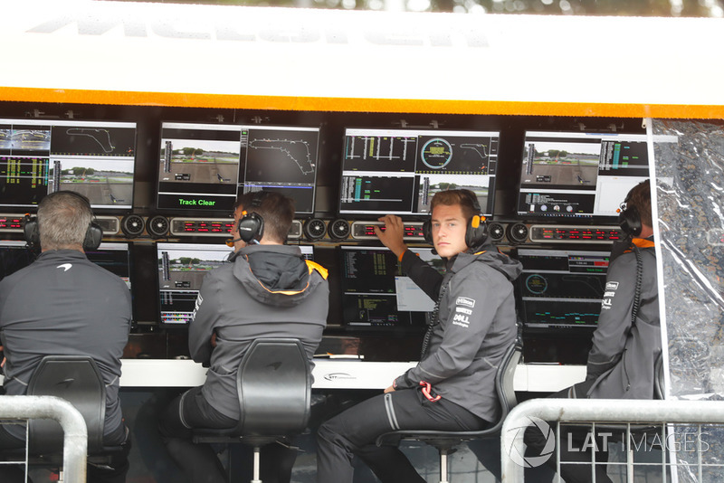 Stoffel Vandoorne, McLaren, watches from the pit wall