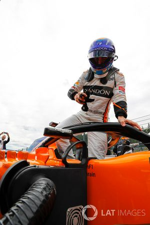 Fernando Alonso, McLaren, climbs out of his car on the grid