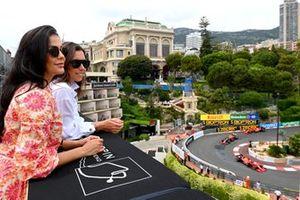 Fans watch as Charles Leclerc, Ferrari SF21, Sergio Perez, Red Bull Racing RB16B, and Carlos Sainz Jr., Ferrari SF21