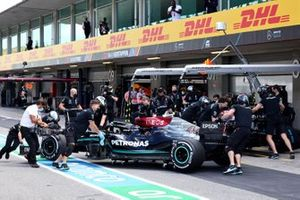 Lewis Hamilton, Mercedes W12, returned to the garage