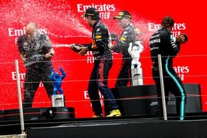 Gianpiero Lambiase, Race Engineer, Red Bull Racing, Sergio Perez, Red Bull Racing, 3rd position, Max Verstappen, Red Bull Racing, 1st position, and Lewis Hamilton, Mercedes, 2nd position, spray Champagne on the podium