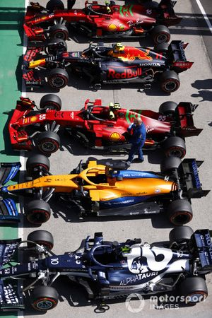 The cars of Pierre Gasly, AlphaTauri AT02, Lando Norris, McLaren MCL35M, Carlos Sainz Jr., Ferrari SF21, Sergio Perez, Red Bull Racing RB16B, and Charles Leclerc, Ferrari SF21, in Parc Ferme after Qualifying