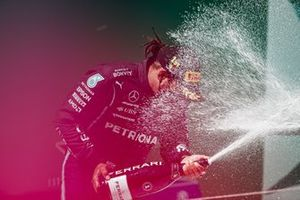 Lewis Hamilton, Mercedes, 1st position, sprays Champagne on the podium