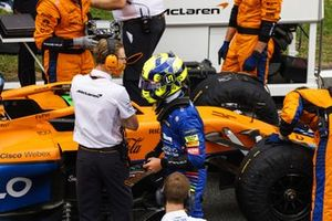 Lando Norris, McLaren MCL35M, on the grid with mechanics prior to the start