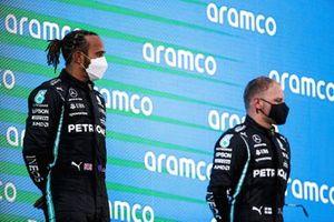 Lewis Hamilton, Mercedes, 1st position, and Valtteri Bottas, Mercedes, 3rd position, on the podium
