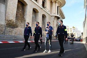Envision Virgin Racing team members walk the track