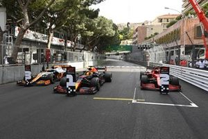 The cars of Lando Norris, McLaren MCL35M, 3rd position, Max Verstappen, Red Bull Racing RB16B, 1st position, and Carlos Sainz Jr., Ferrari SF21, 2nd position, in Parc Ferme