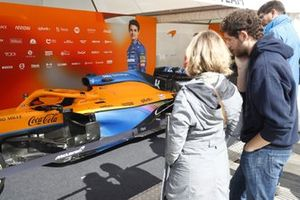 Fans looking at the McLaren MCL35M