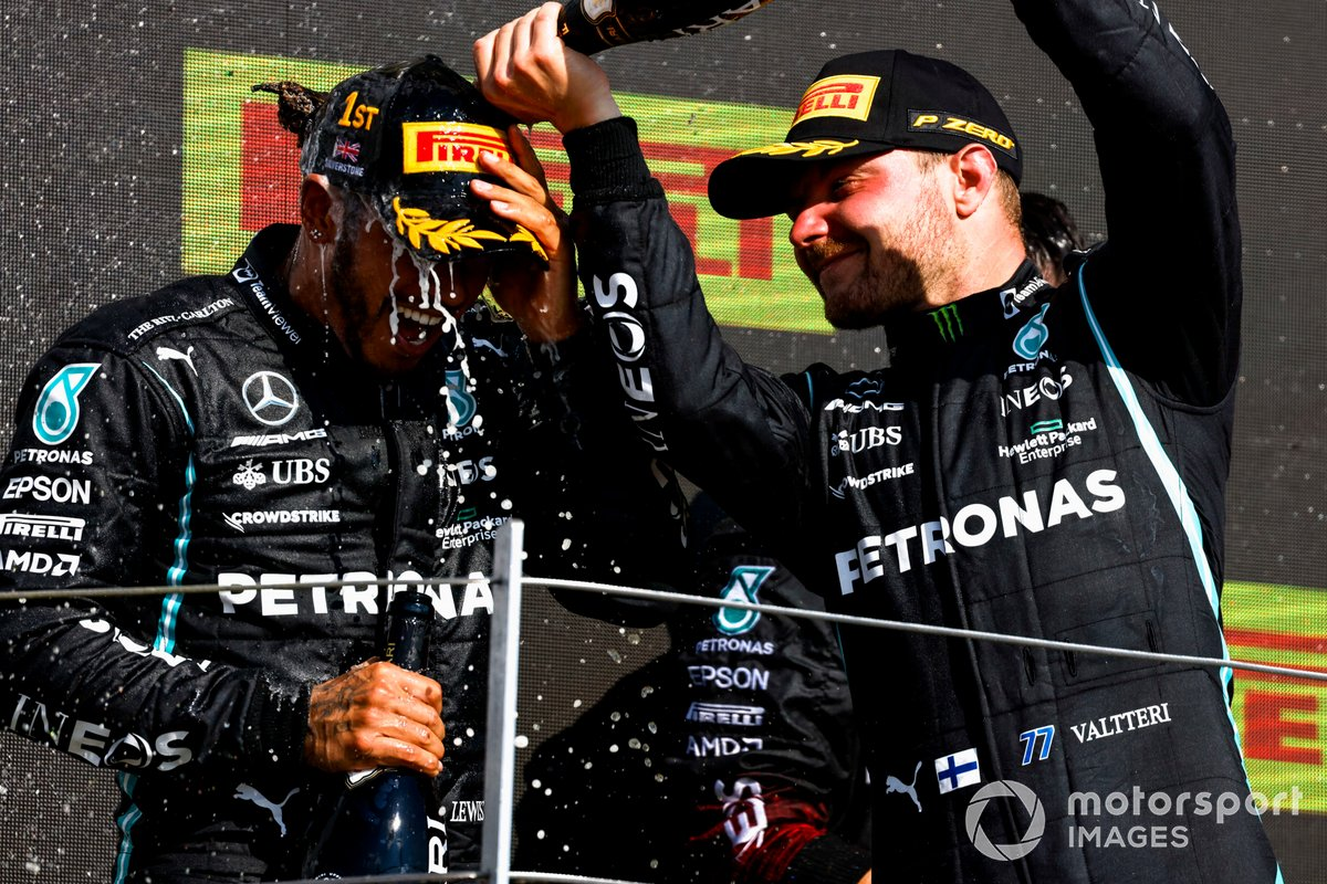 Valtteri Bottas, Mercedes, 3rd position, pours Champagne over Lewis Hamilton, Mercedes, 1st position, on the podium