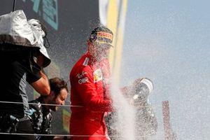 Charles Leclerc, Ferrari, 2nd position, sprays Champagne on the podium