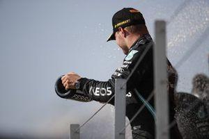 Valtteri Bottas, Mercedes, 3rd position, sprays the Champagne