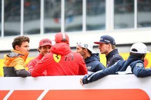 Lando Norris, McLaren, Carlos Sainz Jr., Ferrari, Charles Leclerc, Ferrari, Pierre Gasly, AlphaTauri, and Max Verstappen, Red Bull Racing, in the drivers parade