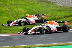 Max Verstappen, Red Bull Racing RB16B, passes as Sergio Perez, Red Bull Racing RB16B, recovers from a spin