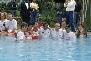 Toyota team celebrate including Luis Moya, Carlos Sainz, Bjorn Waldegaard, Fred Gallagher in the swimming pool