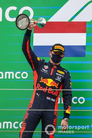Max Verstappen, Red Bull Racing, 2nd position, with his trophy on the podium