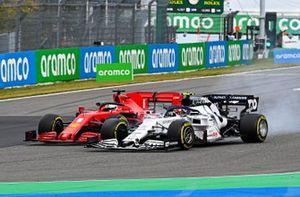 Pierre Gasly, AlphaTauri AT01, battles with Sebastian Vettel, Ferrari SF1000