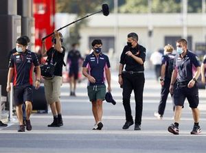 Sergio Perez, Racing Point speaks with Guenther Steiner, Team Principal, Haas F1