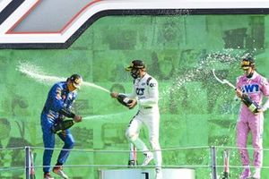Carlos Sainz Jr., McLaren, 2nd position, Pierre Gasly, AlphaTauri, 1st position, and Lance Stroll, Racing Point, 3rd position, celebrate on the podium