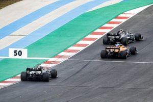 Valtteri Bottas, Mercedes F1 W11, Carlos Sainz Jr., McLaren MCL35, and Lewis Hamilton, Mercedes F1 W11