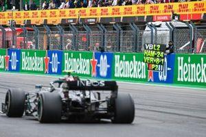 Valtteri Bottas, Mercedes F1 W11, passes his pit board