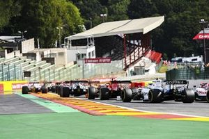 Sebastian Vettel, Ferrari SF1000, and Nicholas Latifi, Williams FW43, chase the pack at the start