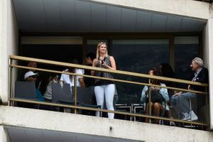 Guests watch from a balcony