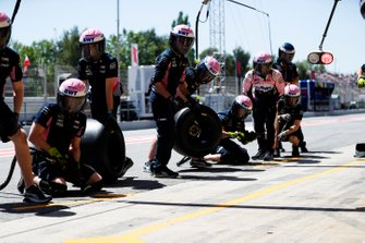 The Racing Point pit crew during practice