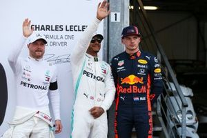 Lewis Hamilton, Mercedes AMG F1, celebrates pole position, alongside Valtteri Bottas, Mercedes AMG F1, and Max Verstappen, Red Bull Racing