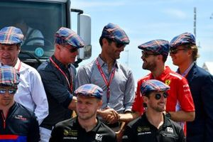 David Coulthard, Mark Webber, Sebastian Vettel, Ferrari, Daniil Kvyat, Toro Rosso, Kevin Magnussen, Haas F1, and Romain Grosjean, Haas F1, join the other drivers in wearing flat caps to celebrate the recent birthday of Sir Jackie Stewart, 3-time F1 Champion