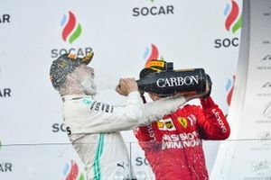 Valtteri Bottas, Mercedes AMG F1, 1st position, blasts himself with Champagne on the podium and Sebastian Vettel, Ferrari, 3rd position, joins in
