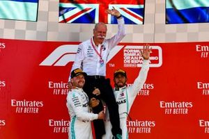 Valtteri Bottas, Mercedes AMG F1, 2nd position, and Lewis Hamilton, Mercedes AMG F1, 1st position, lift Dr Dieter Zetsche, CEO, Mercedes Benz, on their shoulders on the podium