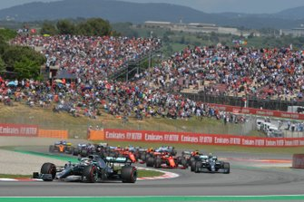 Lewis Hamilton, Mercedes AMG F1 W10, leads Valtteri Bottas, Mercedes AMG W10, Sebastian Vettel, Ferrari SF90, and the rest of the field at the start