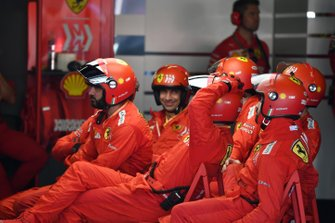 The Ferrari pit crew rest between stops