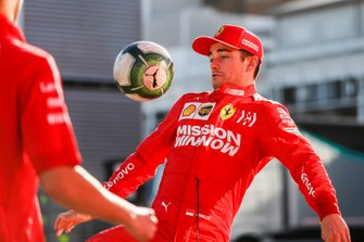 Charles Leclerc, Ferrari, plays football in the paddock