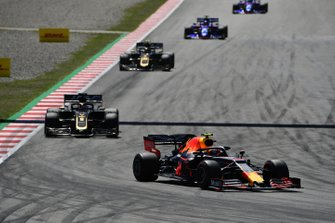 Pierre Gasly, Red Bull Racing RB15, leads Romain Grosjean, Haas F1 Team VF-19, and Kevin Magnussen, Haas F1 Team VF-19