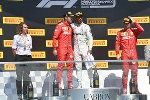 Sebastian Vettel, Ferrari, seconda posizione, Lewis Hamilton, Mercedes AMG F1, prima posizione, e Charles Leclerc, Ferrari, terza posizione, sul podio