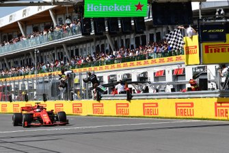 Sebastian Vettel, Ferrari SF90, 2nd position, takes the chequered flag first