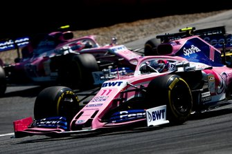 Sergio Perez, Racing Point RP19, leads Nico Hulkenberg, Renault F1 Team R.S. 19, and Lance Stroll, Racing Point RP19
