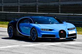 A Bugatti Veyron in the Supercar parade featuring former F1 drivers