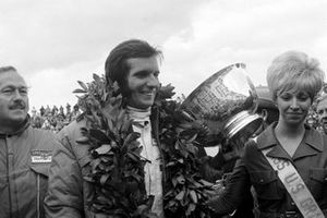 Emerson Fittipaldi, Lotus 72C, wins his first Grand Prix, and ensures Jochen Rindt is World Champion, here with lotus Boss, Colin Chapman