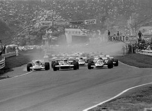 The start, front row Jackie Stewart, Tyrrell 001 and Jacky Ickx, Ferrari 312B get way together with John Surtees on left