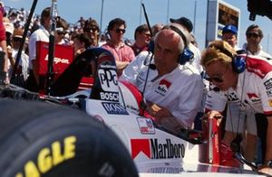 Al Unser Jr., Penske PC23-Mercedes-Benz talks with team boss Roger Penske and his engineers