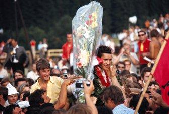 Winner Jacky Ickx celebrates with fans