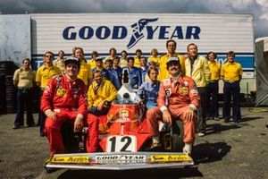 The Ferrari team, with drivers Niki Lauda and Clay Regazzoni, pose for the camera with their championship winning 312T