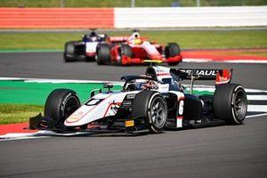 Christian Lundgaard, ART Grand Prix, leads Mick Schumacher, Prema Racing