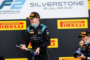 Race winner Dan Ticktum, Dams celebrates on the podium with the champagne with Louis Deletraz, Charouz Racing System